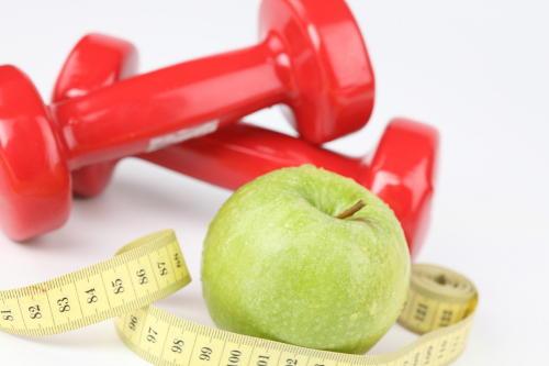 Apfel, Hantel und Massband